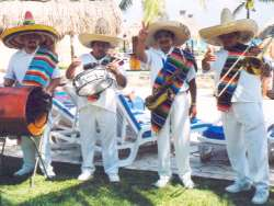 Mexican entertainers at the pool